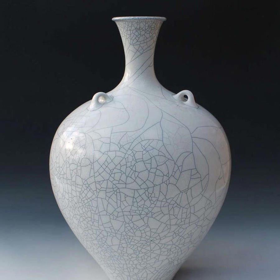Peter Sparrey. Raku fired lugged bottle with tin glaze