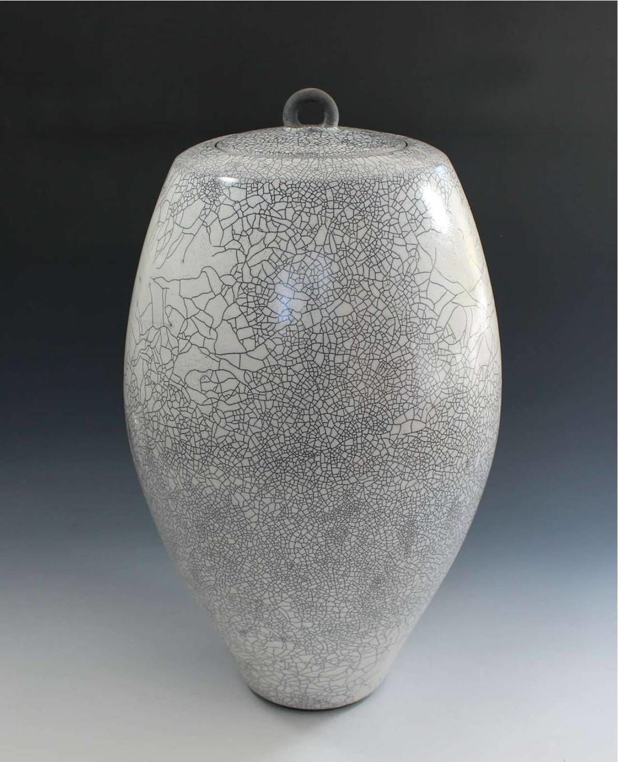 Peter sparrey. Raku lidded Jar with white crackle tin glaze.