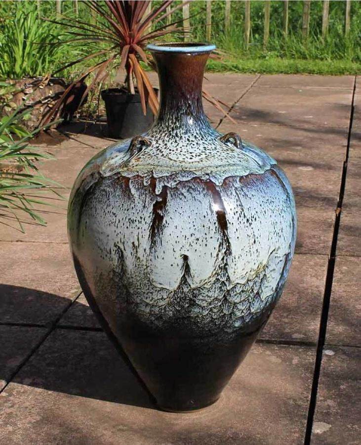 Peter sparrey. Stoneware lugged bottle with chun and tenmoku glaze.